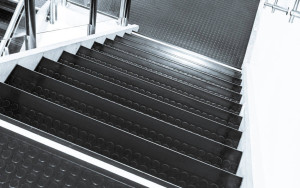 Studded rubber is popular on commercial stairways for its slip resistance